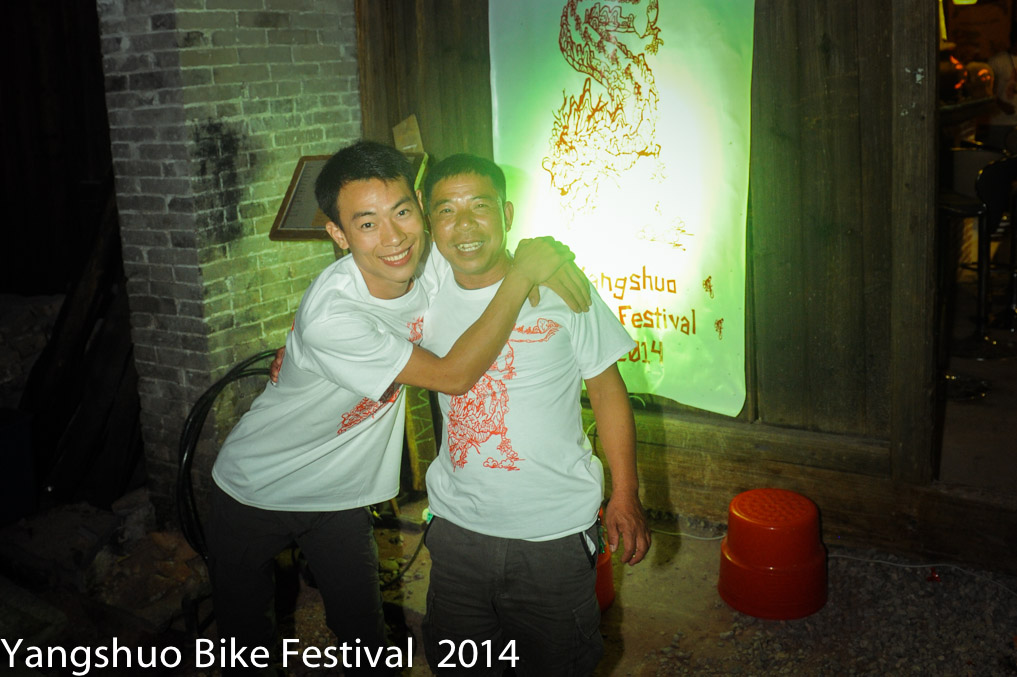 Farmer Tang and Sam from Bike Asia sporting the Great Guangxi Bike Dragon on their festival T-shirts at the Yangshuo Bike Festival launch in Xing Ping.