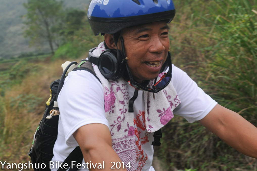 Farmer Tang rocking out to the silent disco on the Xing Ping backroads day 1 of the Yangshuo Bike Festival Ride.