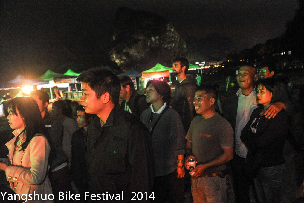 Music is a new experience for Tang who is the  most festive of  the festival goers at  Yangshuo Bike Festival.
